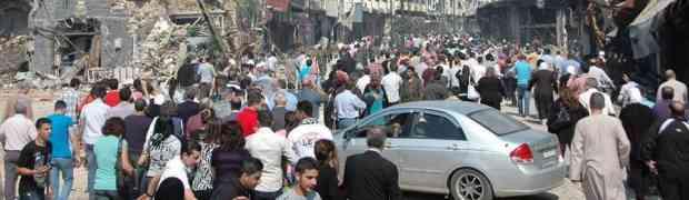 Moradores de Homs retornam em busca de suas casas