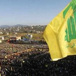 Supporters of Lebanon's Hezbollah leader Sayyed Hassan Nasrallah wave Hezbollah flags as they listen to him via a screen during a rally on the 7th anniversary of the end of Hezbollah's 2006 war with Israel, in Aita al-Shaab village